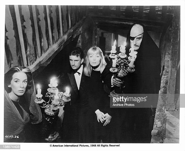 Unidentified group climbing up stairs with candles in a scene from the film 'La Dolce Vita' 1960