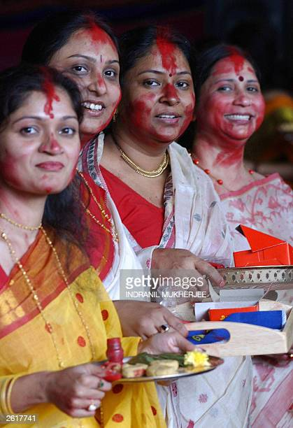 Unidentified Indian Hindu womenhold trays of 'Sindoor' or red dust during the Sindoor Khela Festival on the final day of the Durga Puja Festival...