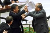 Unidentified lawmakers of the ruling Justice and Development Party and of the main opposition Republican People's Party scuffle during a debate...