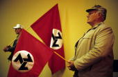 Unidentified members of AWB a right wing movement hold their flags on June 12 2004 in central Potchefstrom South Africa Eugene Terre Blanche the...