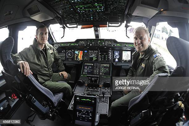 Unidentified members of the French Air Force are seen in the cockpit of an A400M Atlas at the Bolivian Air Force military airport in El Alto some...