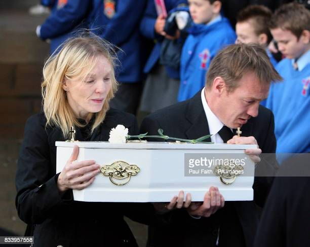 Unidentified members of the McEhill family carry the coffin ninemonthold baby James for burial after requiem mass at the Sacred Heart church in Omagh