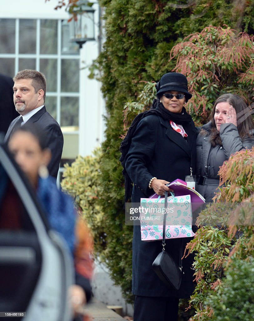 Unidentified mourners arrive at Abraham L. Green and Son Funeral Home in Fairfield, Connecticut, December 17, 2012 during a service for Noah Pozner,6 one of the victims of the elementary school shooting in Newtown, Connecticut. Funerals began Monday after the school massacre that took the lives of 20 small children and six staff, triggering new momentum for a change to America's gun culture. The first burials, held under raw, wet skies, were for two six-year-old boys who were among those shot in Sandy Hook Elementary School. On Tuesday, the first of the girls, also aged six, was due to be laid to rest. There were no Monday classes at all across Newtown, and the blood-soaked elementary school was to remain a closed crime scene indefinitely, authorities said. AFP PHOTO/Don Emmert
