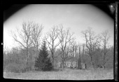 Unidentified old Dutchstyle house surrounded by bare trees New York New York late 19th or early 20th century