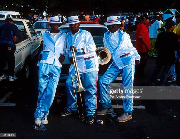 Unidentified participants take a break January 2 2003 during the yearly 'Coon Carnival' in BoKaap a Muslim area of Cape Town South Africa The...