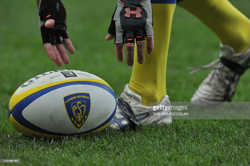 A unidentified player of Clermont picks up the ball during the French Top 14 rugby union match between Clermont Auvergne and Montpellier Herault...