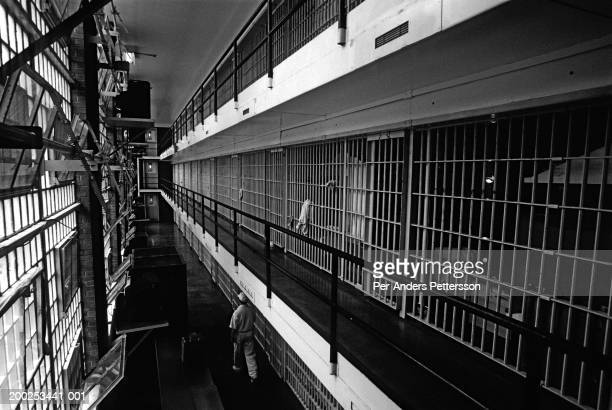 Unidentified prisoner on Death Row walks in the corridor on April 16 1997 at Ellis Unit in Huntsville Texas USA Texas has about 450 prisoners on...
