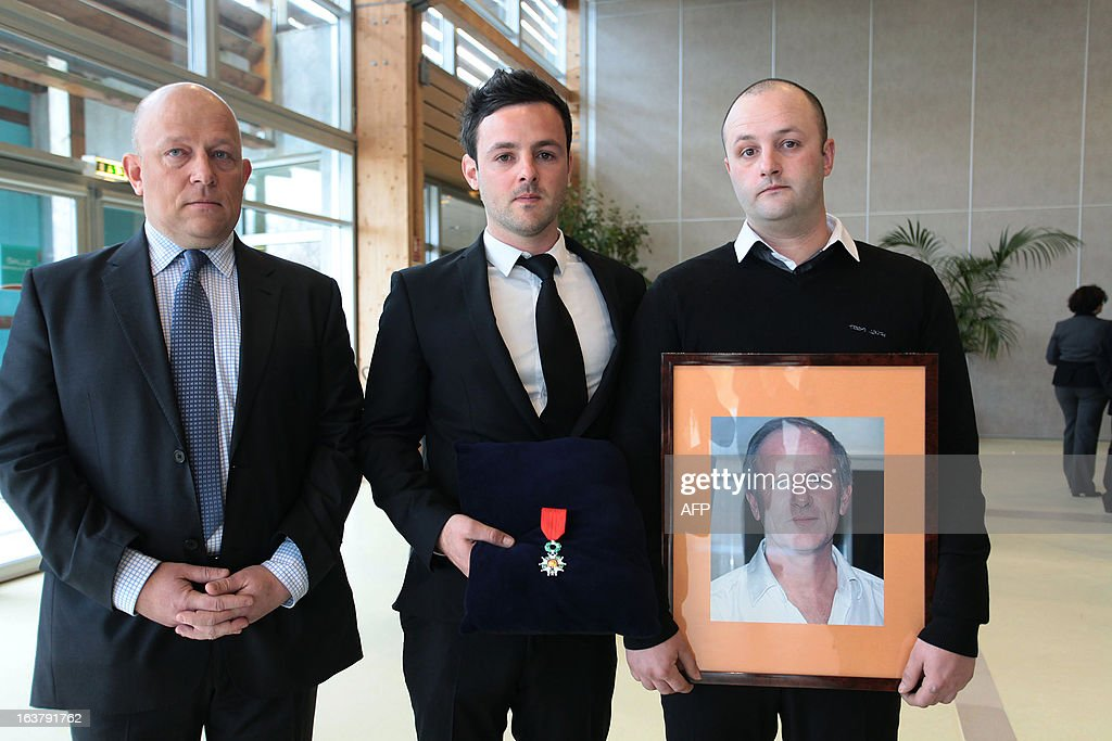 Unidentified relatives of Yann Desjeux a former French Marine Infantry paratrooper who was killed on January 18 2013 when the Algerian army stormed a...