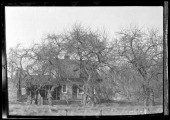 Unidentified small woodshake house open front porch and addition Partly hidden by bare trees New York New York late 19th or early 20th century