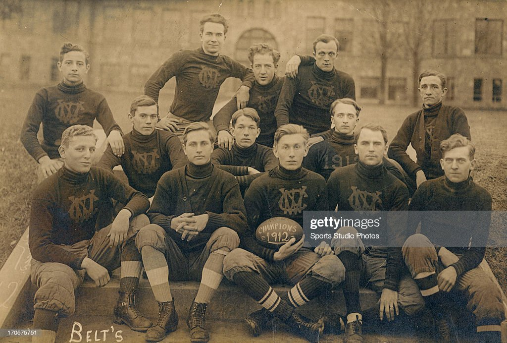 Unidentified varsity football team posing for a group shot in uniform.
