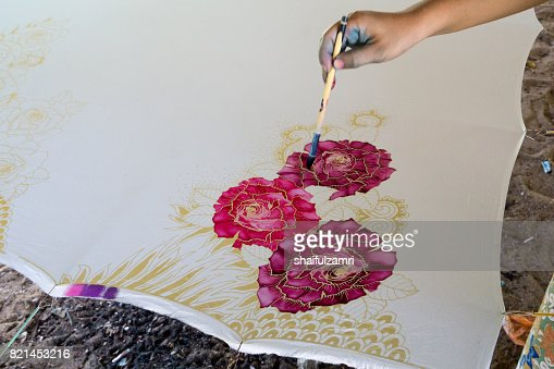 Unidentified woman use dye to make a 'Batik'. Making of Batik is part of Malaysia culture and tourist attraction in Kota Baharu, Kelantan. : Stock Photo