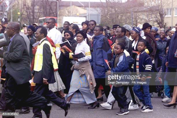 Unidentified women singing during the march in south London in support of Damilola Taylor who was murdered in Peckham Several churches in Damilola's...