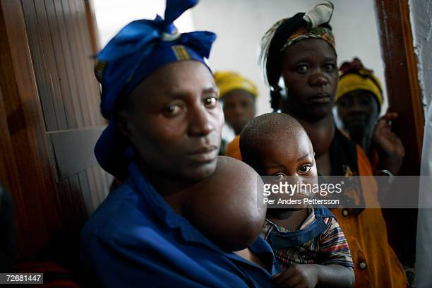 Unidentified women suffering from Goiter stands in a hospital ward with their children on October 4 2006 in central Goma DRC The hospital is run by...