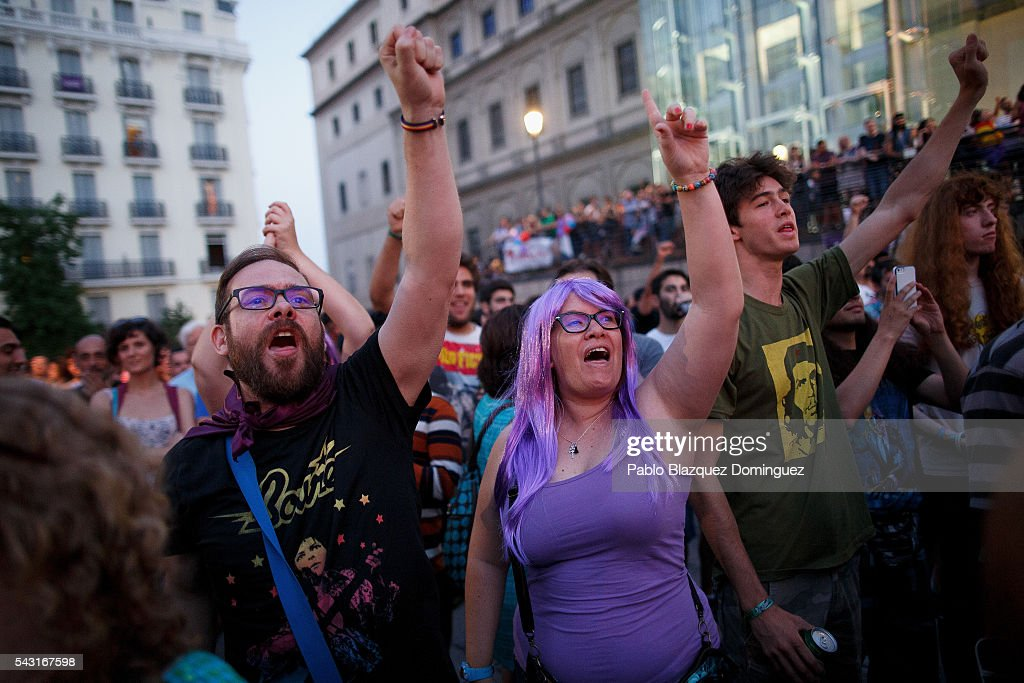 Unidos Podemos (United We Can) supporters cheer as they watch on a big screen the first poll results at a gathering on the Spanish General Elections day on June 26, 2016 in Madrid, Spain. Spanish voters head back to the polls after the last election in December failed to produce a government. Latest opinion polls suggest the Unidos Podemos left-wing alliance could make enough gains to come in second behind the ruling center right Popular Party.