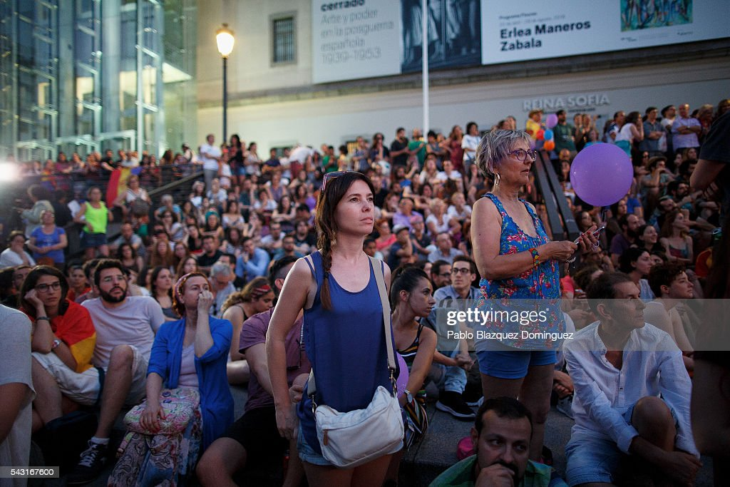 Unidos Podemos (United We Can) supporters watch on big screen the first poll results at a gathering on the Spanish General Elections day on June 26, 2016 in Madrid, Spain. Spanish voters head back to the polls after the last election in December failed to produce a government. Latest opinion polls suggest the Unidos Podemos left-wing alliance could make enough gains to come in second behind the ruling center right Popular Party.