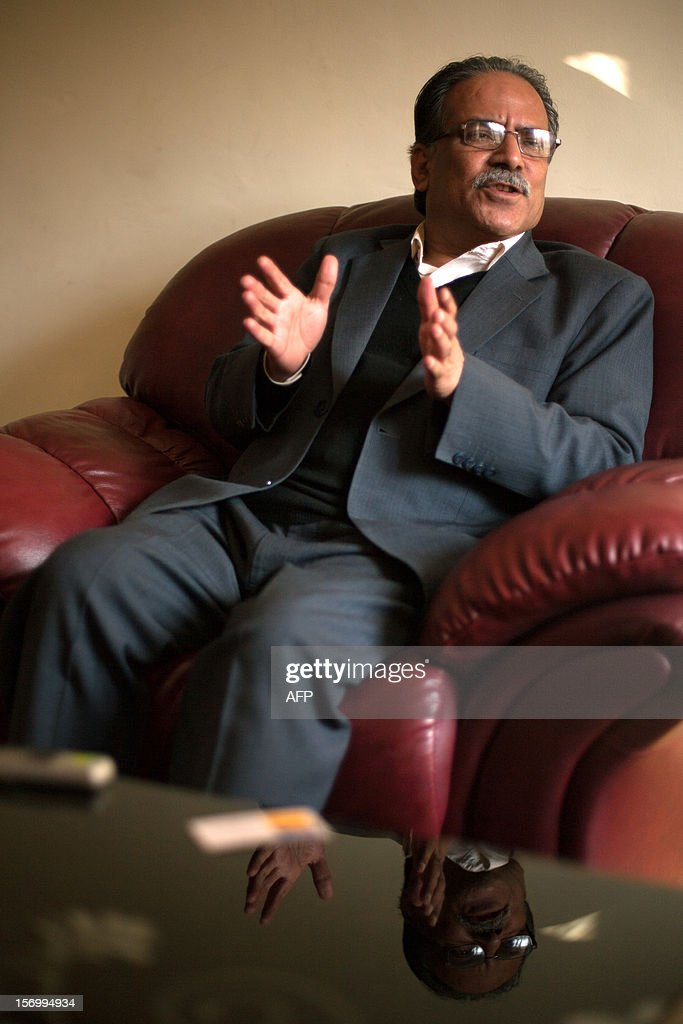 Unified Communist Party of Nepal (Maoist) Chairman, Pushpa Kamal Dahal, also known as 'Prachanda' gestures as he speaks during an interview in Kathmandu on November 27, 2012. The leader of Nepal's Maoists proposed a new unity government, offering political rivals the pick of the top cabinet posts in a bid to end the deadlock crippling the restive Himalayan nation. Maoist party chairman Pushpa Kamal Dahal told AFP he would let his rivals in the two largest opposition parties choose their ministries if they agreed to unite behind a Maoist premier in a cross-party administration. AFP PHOTO/MATTHIEU ALEXANDRE