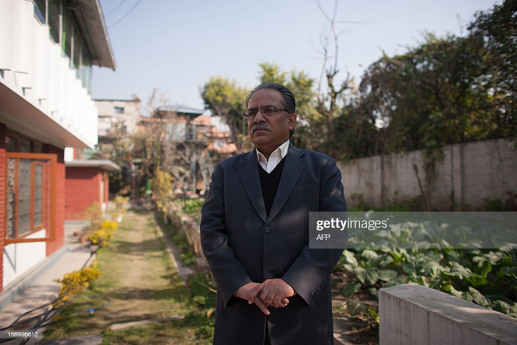 Unified Communist Party of Nepal (Maoist) Chairman, Pushpa Kamal Dahal, also known as 'Prachanda' poses after giving an interview in Kathmandu on November 27, 2012. The leader of Nepal's Maoists proposed a new unity government, offering political rivals the pick of the top cabinet posts in a bid to end the deadlock crippling the restive Himalayan nation. Maoist party chairman Pushpa Kamal Dahal told AFP he would let his rivals in the two largest opposition parties choose their ministries if they agreed to unite behind a Maoist premier in a cross-party administration.