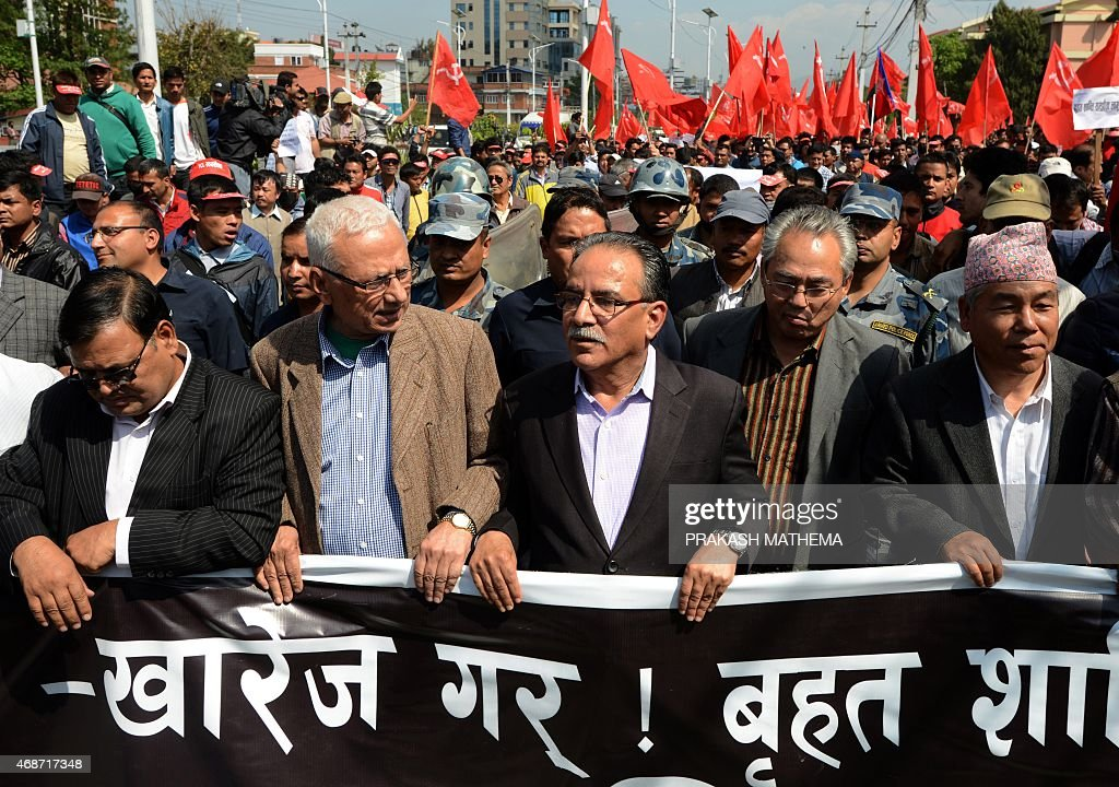 Unified Communist Party of Nepal (Maoist) chairman <a gi-track='captionPersonalityLinkClicked' href=/galleries/search?phrase=Pushpa+Kamal+Dahal&family=editorial&specificpeople=565314 ng-click='$event.stopPropagation()'>Pushpa Kamal Dahal</a>, also known as Prachanda (C), and other leaders from Nepalese Maoist parties take part in a demonstration against an order from the country's top court to two bodies, set up to investigate war crimes committed during the country's decade-long civil conflict, not grant grant amnesty for serious rights abuses on April 6, 2015. Former Maoist rebels and security forces have both been accused of carrying out torture, killings, rape and 'forced disappearances' during the civil war, which left 16,000 dead. AFP PHOTO/ PRAKASH MATHEMA