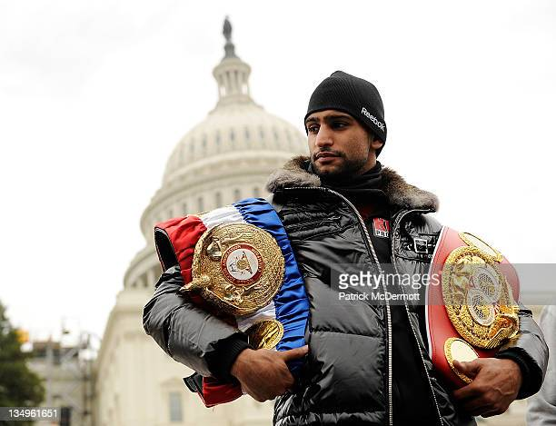 Unified LightWelterweight Champion of the World Amir Khan stands for a photo on the steps of the US Capitol Building on December 5 2011 in Washington...