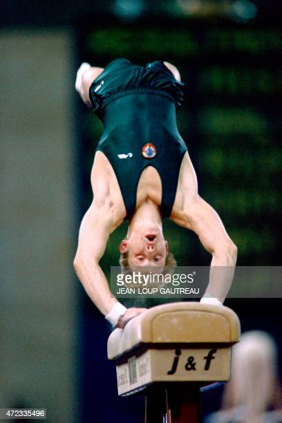 Unified Team's Vitaly Scherbo does a handspring vault during the men's individual gymnastics finals 02 August 1992 at the Barcelona Olympic Games...
