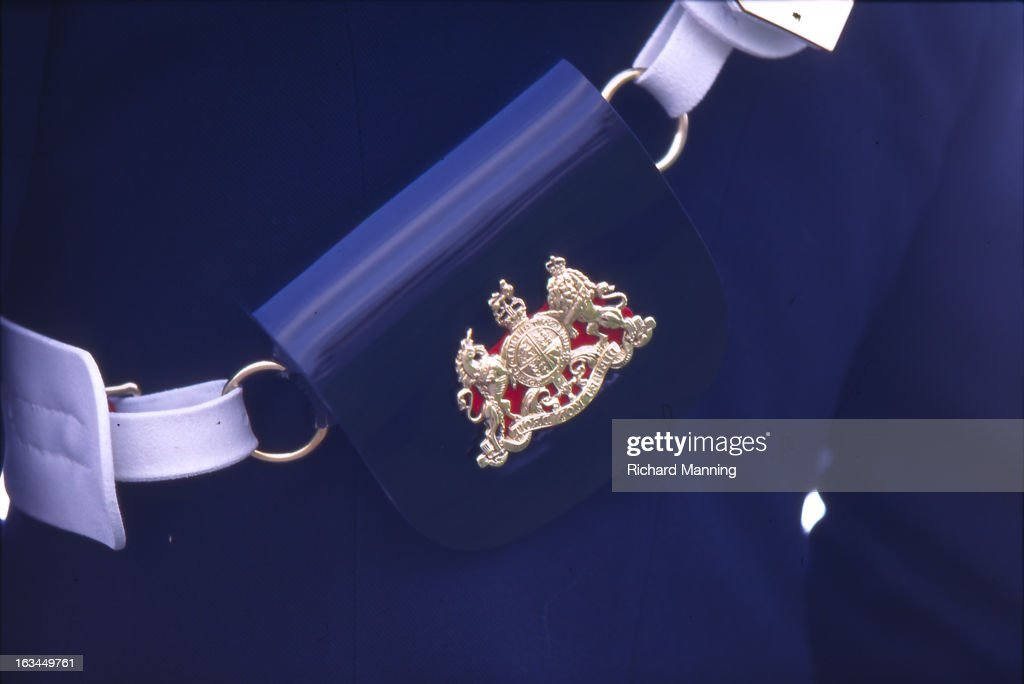 A uniform detail from the Grand Military Gold Cup, held annually at Sandown Park Racecourse in Esher, Surrey. It is a meeting point for the Military, in particularly for Cavalry Officers, with its origins in the days when mounted Cavalry Officers still rode to war.
