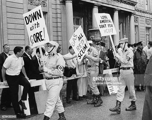 Uniformed Members of American Nazis Staging Own Protest Outside Hearing Room of the House UnAmerican Activities Committee Chicago Illinois USA 1965