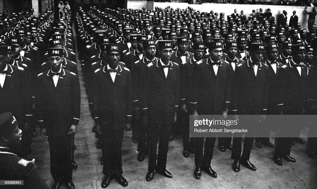 Uniformed men in the uniform of the Fruit of Islam, a subset of the Nation of Islam, stand at attention during the Saviour's Day celebrations at General Richard Jones Armory, Chicago, Illinois, February 26, 1967.