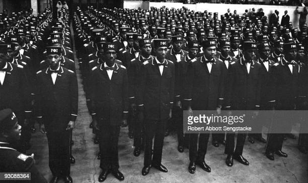 Uniformed men in the uniform of the Fruit of Islam a subset of the Nation of Islam stand at attention during the Saviour's Day celebrations at...