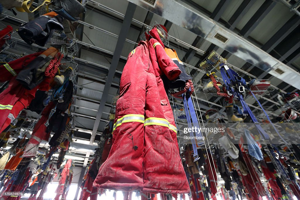 Uniforms for the underground pit workers hang in the No. 1 shaft building at the Oyu Tolgoi copper-gold mine, jointly owned by Rio Tinto Group's unit Turquoise Hill Resources Ltd. and Erdenes Oyu Tolgoi LLC, in Khanbogd, the South Gobi desert, Mongolia, on Friday, June 7, 2013. Rio Tinto, the world's second-biggest mining company, is expected to start first shipments from its $6.6 billion copper-gold mine in Mongolia this month. Photographer: Tomohiro Ohsumi/Bloomberg via Getty Images