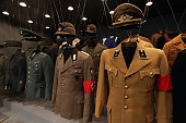 Uniforms of Nazi criminal Adolf Hitler and his regime are pictured during a press preview of 'Hitler and the Germans Nation and Crime' at Deutsches...