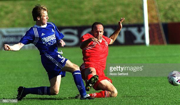 UniMount's Billy Harris right tackles Napier City Rovers Ricky Ravenhill in the Ansett National Soccer League match at Bill McKinlay Park Auckland...