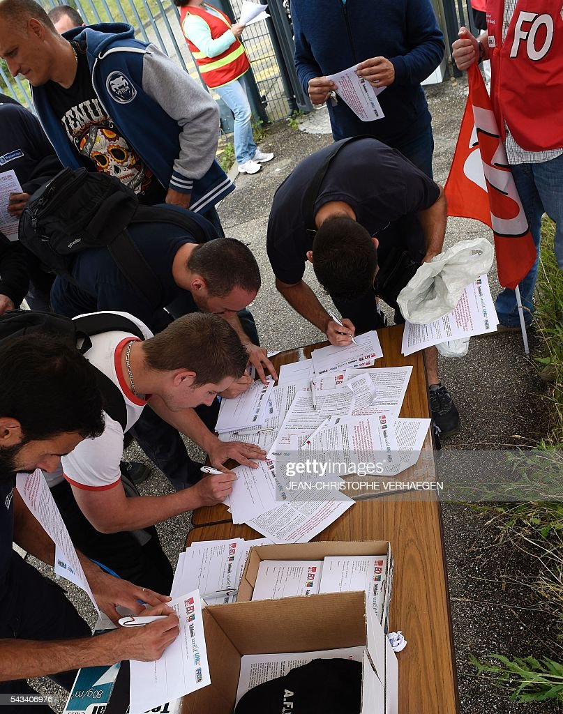 Union activists and workers organize a citizens' poll on the French controversal reforms in front of the Smart plant in Hambach, eastern France, on June 28, 2016. Thousands of people took to the streets of Paris on June 28 in the latest protest march in a marathon campaign against the French Socialist government's job market reforms. The march, along with a strike that shut down the Eiffel Tower, came as the French Senate prepared to vote on the hotly contested reforms aimed at reining in unemployment by freeing up the job market. VERHAEGEN