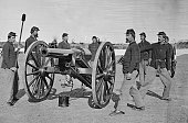 A Union Army artillery squad prepares to fire their cannon during a drill Virginia 1860s