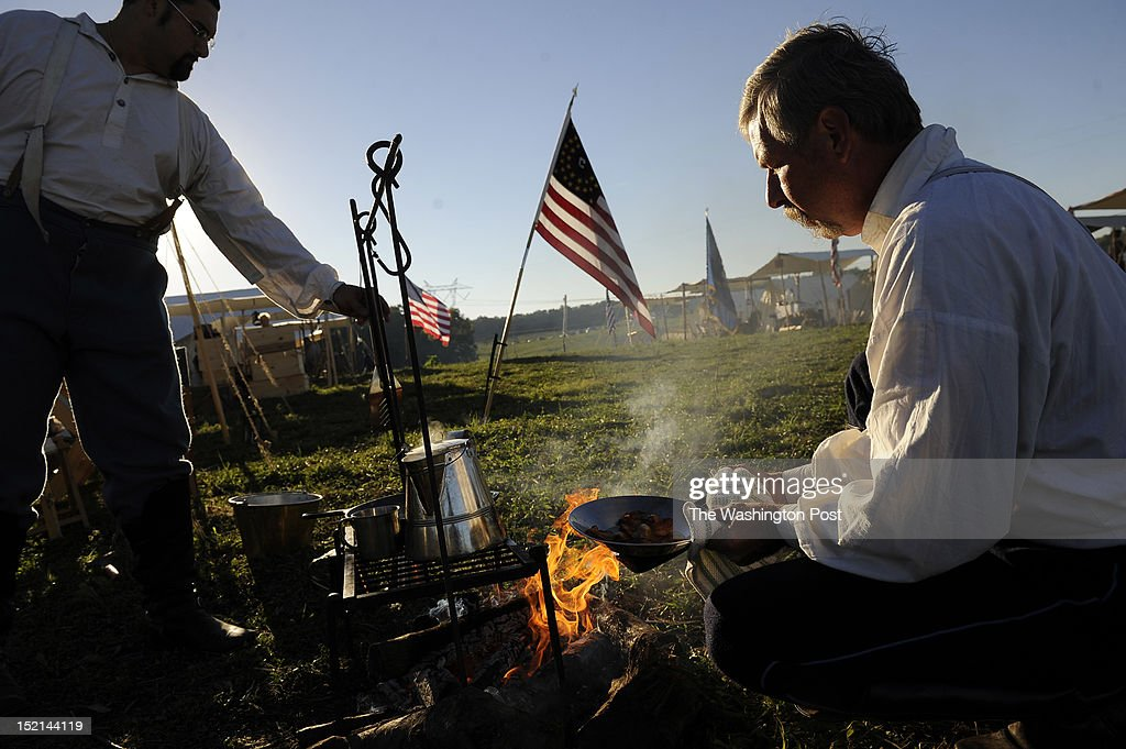 Union Army Re-enactors, Michael Stepnowski, left, of Yardley, PA and David Starliper, right, of Summit Point, WV are seen around fa fire as people gather to mark the 150th anniversary of the Battle of Antietam on Saturday September 15, 2012 just outside of Sharpsburg, MD, not far from the Antietam National Battlefield. The true anniversary of the battle is September 17th. It is known as being the bloodiest battle for a single day in U.S. history.