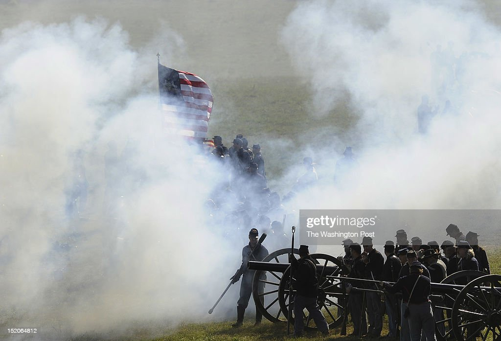 Union Army Reenactors take part in a recreation entitled 'Dunker Church' as people gather to mark the 150th anniversary of the Battle of Antietam on...