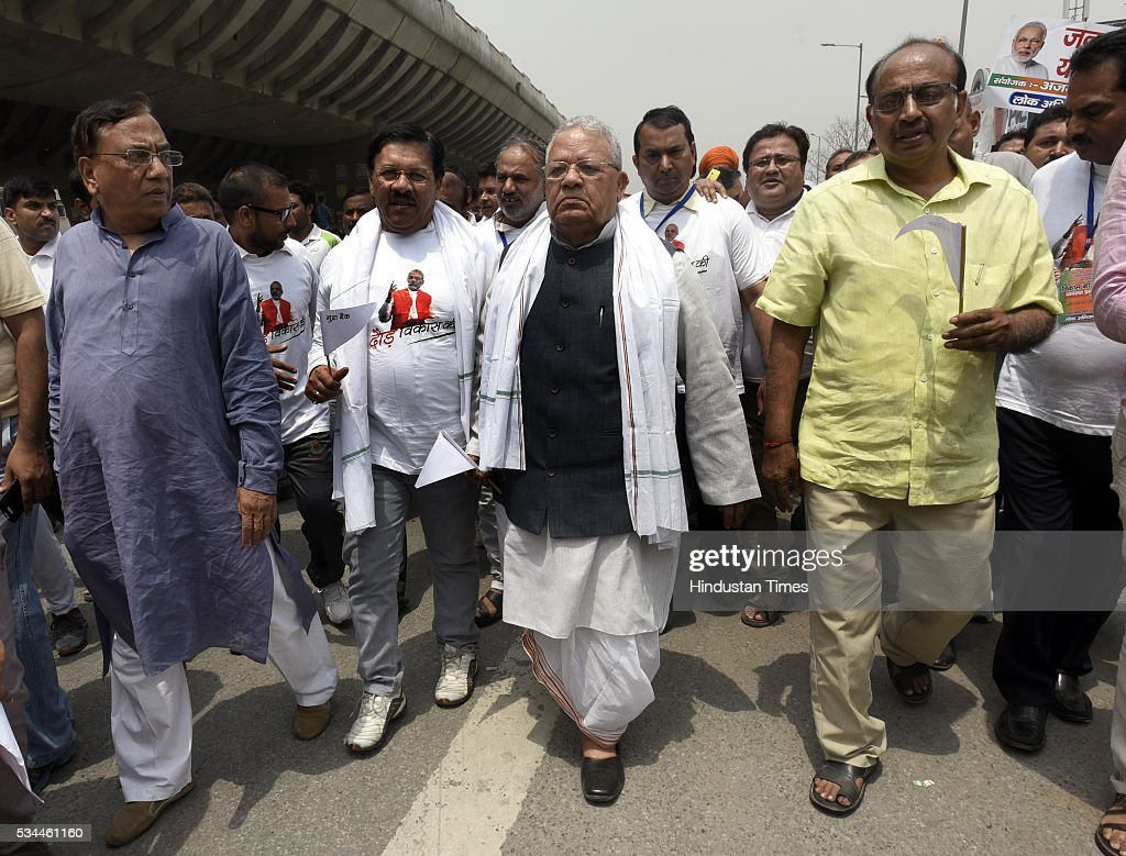 Union Cabinet Minister of Micro, Small and Medium Enterprises Kalraj Mishra, BJP Rajya Sabha MP Vijay Goel Delhi BJP Incharge Shyam Jaju, and other Leader and party worker participating in the Run for Development celebrating achievements of two years of Modi-led government from Khajoori Chowk to Bhajan Pura, on May 26, 2016 in New, India.