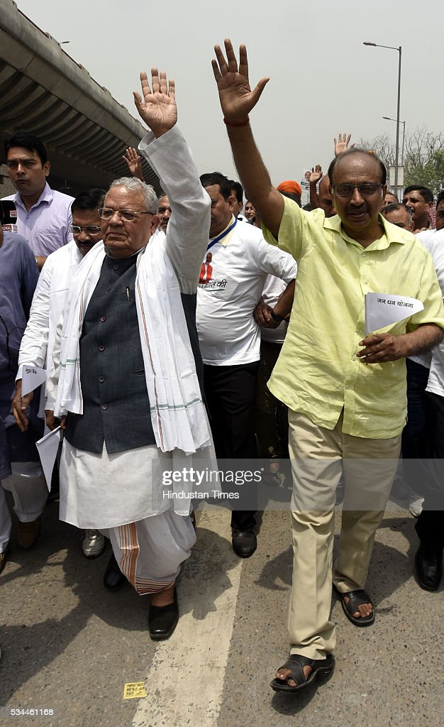 Union Cabinet Minister of Micro, Small and Medium Enterprises Kalraj Mishra, BJP Rajya Sabha MP Vijay Goel and other Leader and party worker participating in the Run for Development celebrating achievements of two years of Modi-led government from Khajoori Chowk to Bhajan Pura, on May 26, 2016 in New, India.