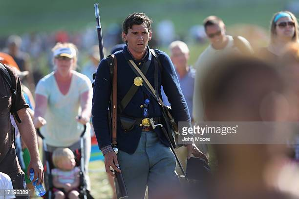 Union Civil War reenactor walks with spectators after taking part in a threeday Battle of Gettysburg reenactment on June 29 2013 in Gettysburg...