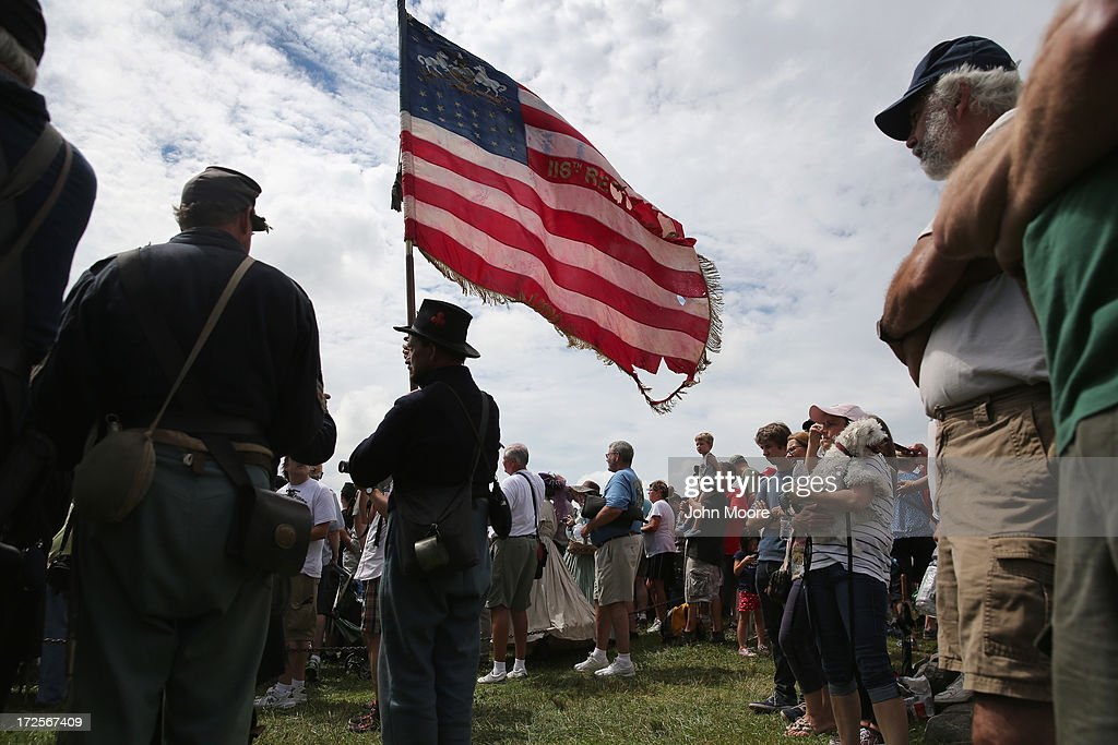 Union Civil War re-enactors and others watch as thousands of civilians re-enact Pickett's Charge on the 150th anniversary of the historic Battle of Gettysburg on July 3, 2013 in Gettysburg, Pennsylvania . The Rebel charge, which occurred on July 3, 1863, the last day of the three-day battle, was a decisive Union victory and widely considered the turning point in the American Civil War. Federal and Confederate armies suffered a combined total of 51,000 casualties over three days, the highest number of any battle in the four-year war.