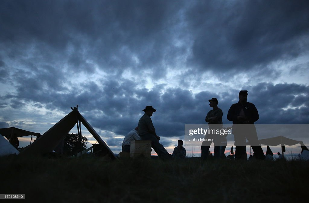 Union Civil War re-enactors await nightfall while camped at the Gettysburg National Military Park on the 150th anniversary of the historic battle on July 1, 2013 in Gettysburg, Pennsylvania. The Union victory, which took place July 1-3, 1863, is widely considered the turning point in the American Civil War. Union and Confederate armies suffered a combined total of up to 51,000 casualties over three days, the highest number of any battle in the four-year war.