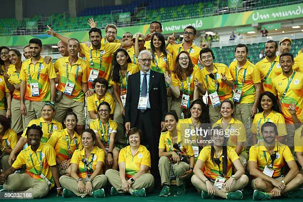 Union Cycliste Internationale President Brian Cookson takes a photo with Rio 2016 workers on Day 11 of the Rio 2016 Olympic Games at the Rio Olympic...