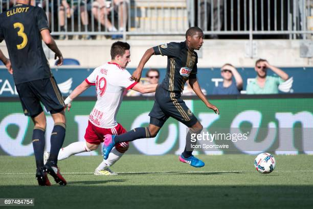 Union D Ray Gaddis keeps the ball from Red Bulls MF Alex Muyl in the first half during the game between the New York Red Bulls and Philadelphia Union...