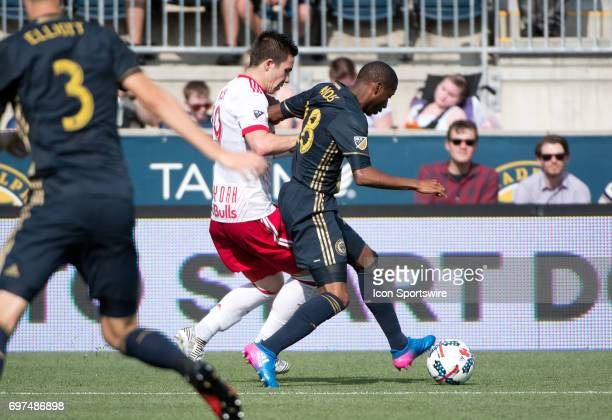 Union D Ray Gaddis shields the ball from Red Bulls MF Alex Muyl in the first half during the game between the New York Red Bulls and Philadelphia...