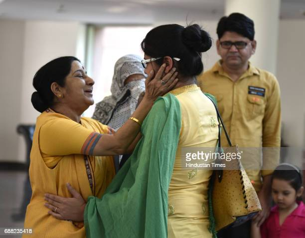 Union External Affairs Minister Sushma Swaraj greets Uzma Ahmed at Jawahar Bhawan after her return from Pakistan on May 25 2017 in New Delhi India...