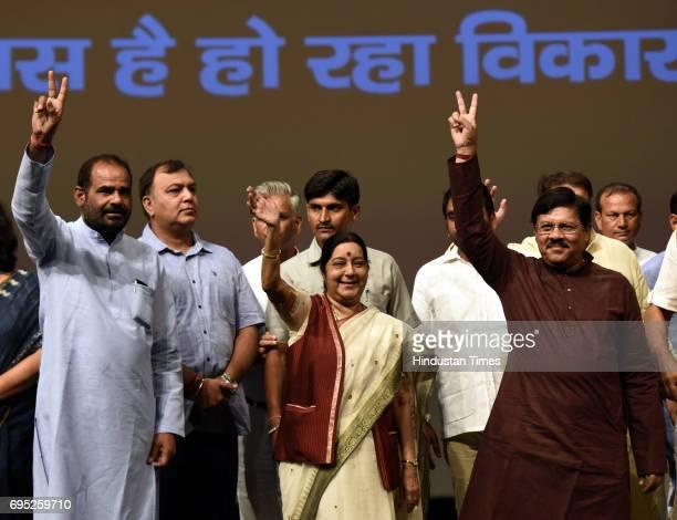 Union External Affairs Minister Sushma Swaraj South Delhi MP Ramesh Bidhuri National Vice President and Delhi BJP Incharge Shyam Jaju wave to people...