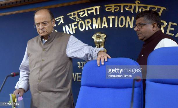 Union Finance Minister Arun Jaitley and Minister of Law and Justice Ravi Shankar Prasad arrive for the press conference after cabinet meeting at PIB...