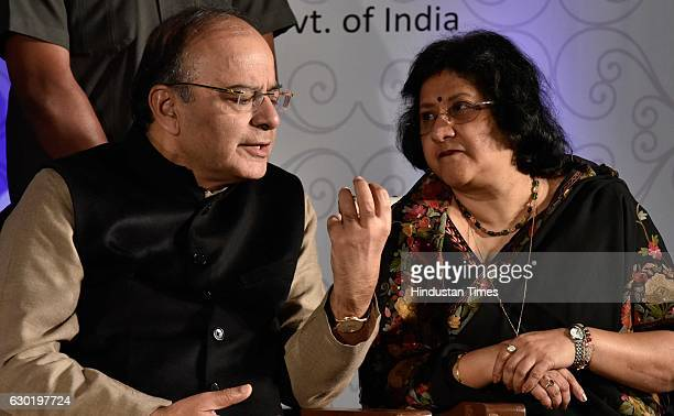Union Finance Minister Arun Jaitley and SBI Chairman Arundhati Bhattacharya during the launch of Mobicash a joint service of SBI and BSNL at a city...