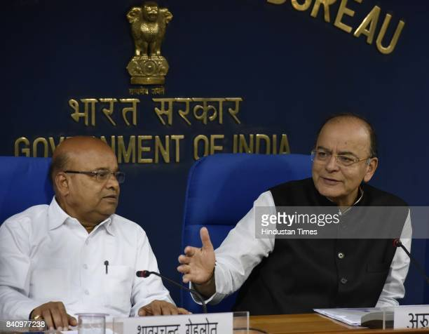 Union Finance Minister Arun Jaitley and Union Minister for Social Justice and Empowerment Thawar Chand Gehlot brief the media after cabinet meeting...