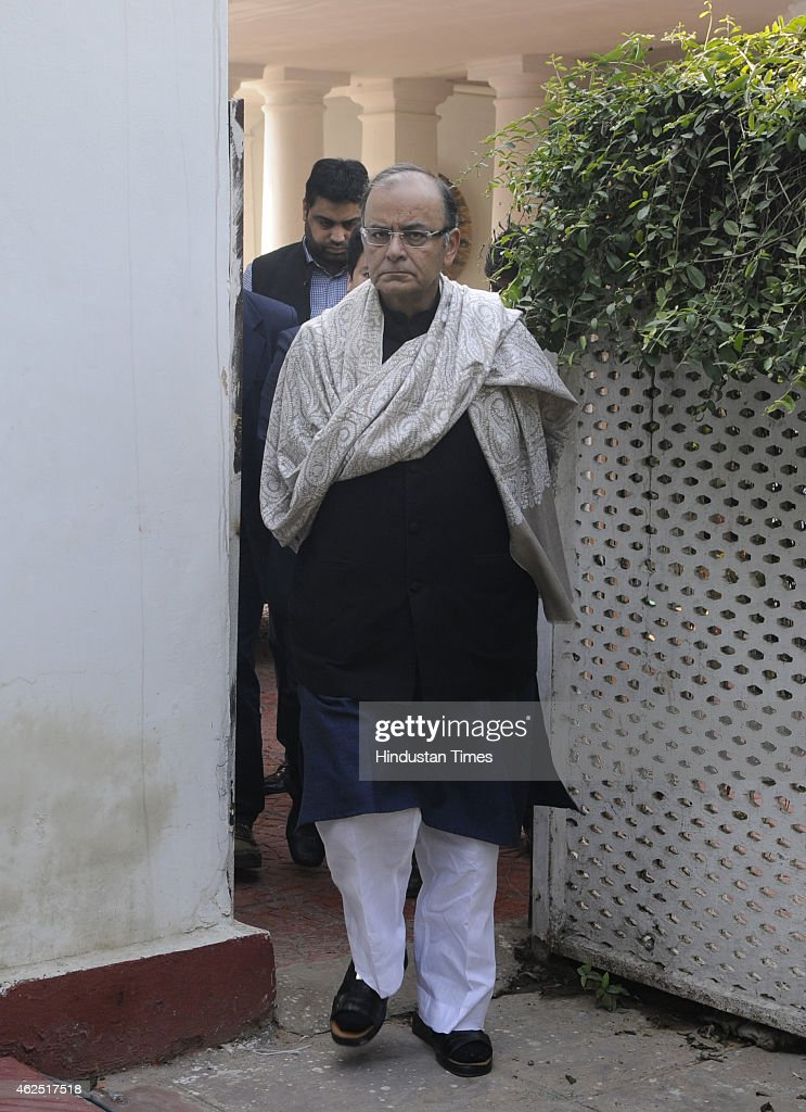 Union Finance Minister <a gi-track='captionPersonalityLinkClicked' href=/galleries/search?phrase=Arun+Jaitley&family=editorial&specificpeople=2660950 ng-click='$event.stopPropagation()'>Arun Jaitley</a> arrives to address the media persons about the allegations of Congress leader Jayanti Natrajan on Congress Vice President Rahul Gandhi at his residence at on January 30, 2015 in New Delhi, India. Union Minister <a gi-track='captionPersonalityLinkClicked' href=/galleries/search?phrase=Arun+Jaitley&family=editorial&specificpeople=2660950 ng-click='$event.stopPropagation()'>Arun Jaitley</a> sought a review of environmental projects granted clearance or rejected permission during the UPA regime after former Environment Minister Jayanthi Natarajan accused Rahul Gandhi of interference in green clearances for projects.