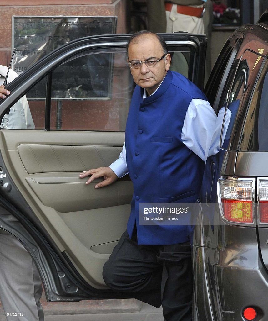 Union Finance Minister <a gi-track='captionPersonalityLinkClicked' href=/galleries/search?phrase=Arun+Jaitley&family=editorial&specificpeople=2660950 ng-click='$event.stopPropagation()'>Arun Jaitley</a> arrives to presents the Budget 2015-16 in Parliament, that aims to ramp up growth, aided by a slowed pace of fiscal deficit cuts and a raft of tax measures to put private domestic and foreign capital to work, at North Block on February 28, 2015 in New Delhi, India. Jaitley promised higher investment in India's decrepit roads and railways, offered the carrot of corporate tax cuts to global corporations and the stick of tighter compliance rules to get Indian tycoons to invest at home rather than stash wealth abroad. He forecast inflation at 5% by the end of the fiscal year ending March 2016, undershooting the Reserve Bank of India's 6% target and creating room to cut interest rates. Annual inflation was 5.1% in January. He proposed to abolish the wealth tax and proposed two percent surcharge on the super rich. He said the government is proposing to rationalise various tax exemptions and incentives to reduce tax disputes and improve tax administration.